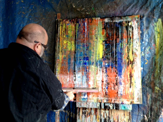 photo: artist and teacher Jan Boudewijn working in the studio